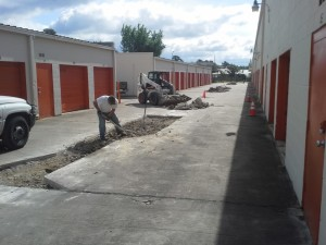 image of crew repairing storage facility parking lot